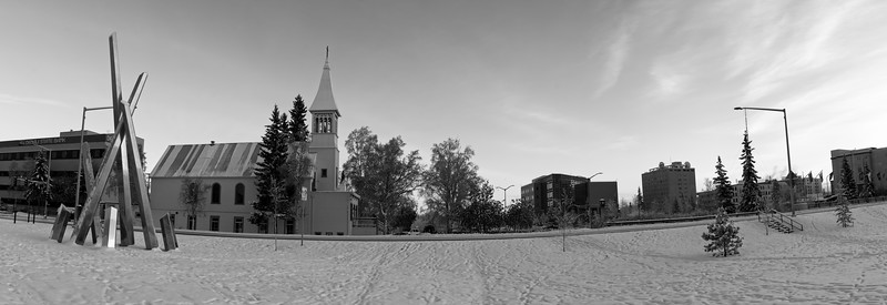 Panorama of the new Polaris sculpture and Immaculate Conception Church and the downtown Fairbanks