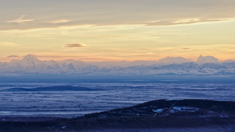 The Alaska Range juts out of the flat Tanana Valley, about 80 miles south of Fairbanks.