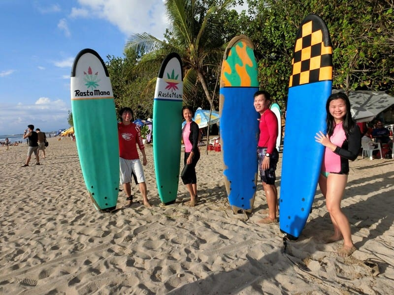 outdoor adventures in Bali - Kuta Beach at Bali Indonesia   We and our big colourful boards. Behind those smiles are exhausted aching bodies and nose and mouth full of saltwater