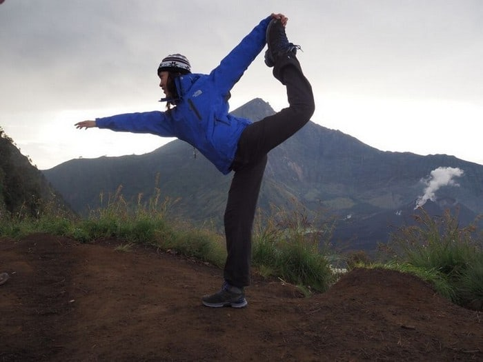 Attempting a yoga dancer pose on the mount rinjani trek