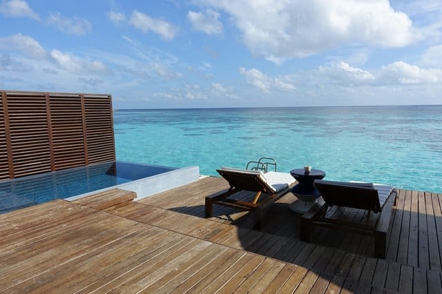 infinity pool and gorgeous deck chairs. Maldives Beach Paradise