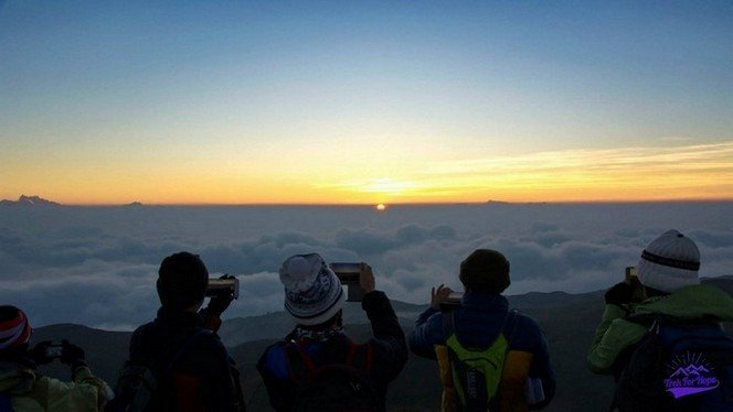 photographing down the moments as the sun rises - trek for hope