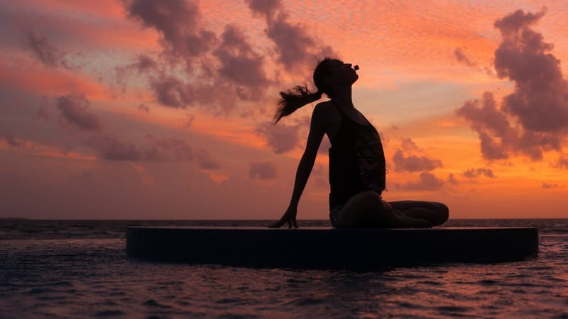 Yoga at Sunset. Breathe in and flow with the breeze at the Extreme Wow Suite