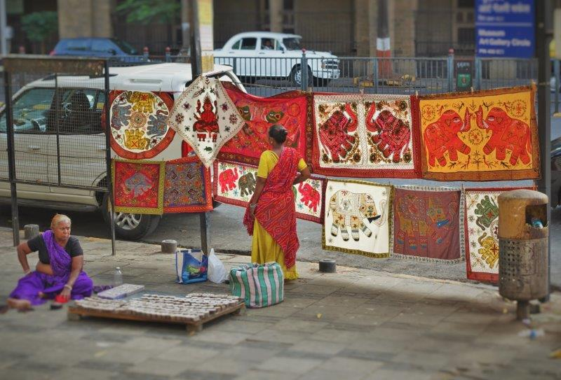 Pretty carpets and artwork on sale along the streets