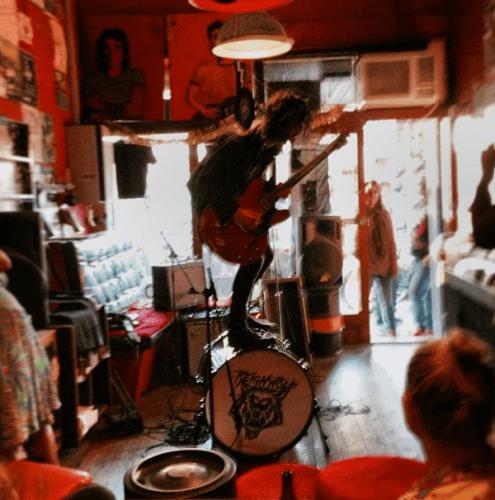Reignwolf performs inside Bonn Scott's son's record shop in Australia.