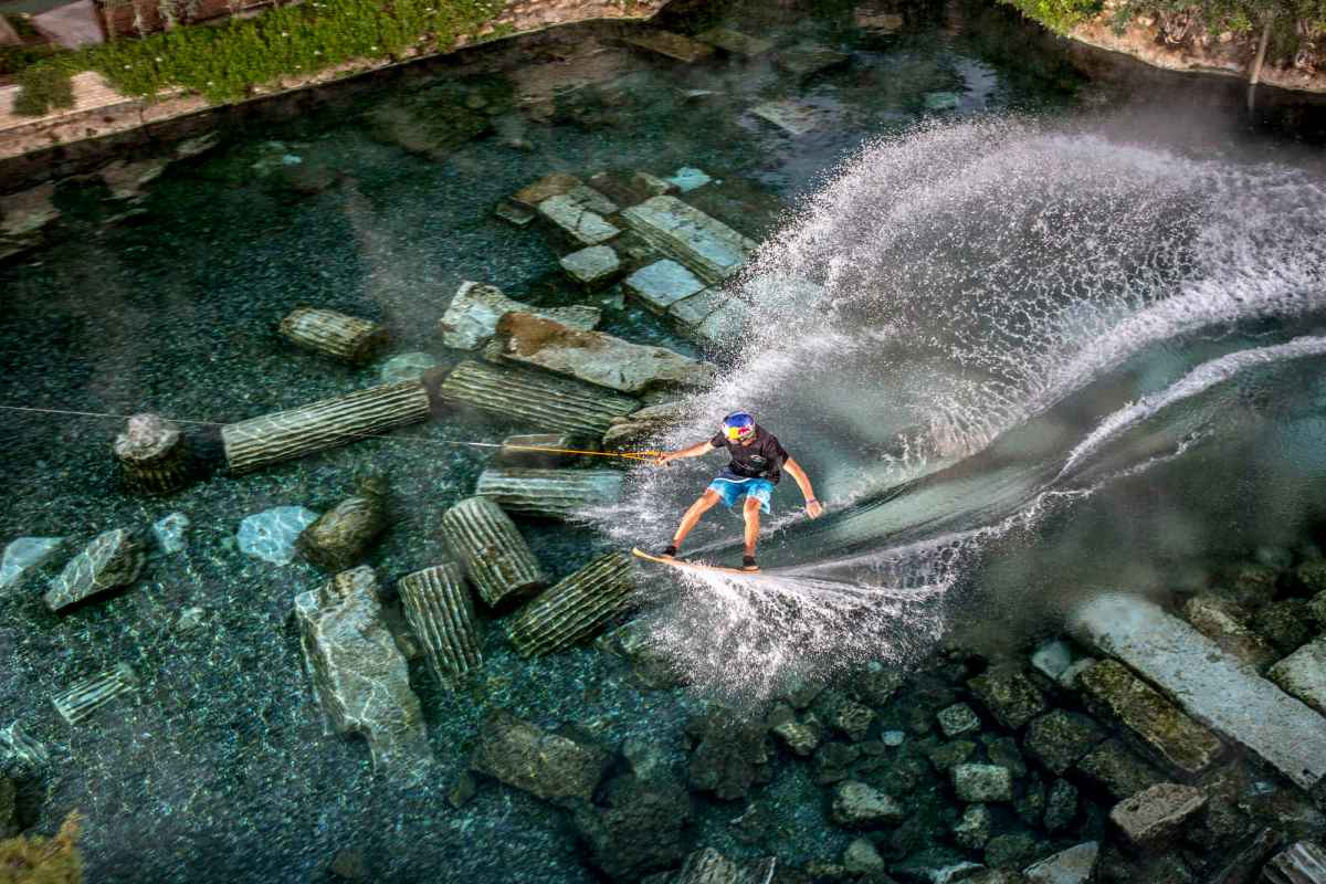 Brian Grubb performs during the Red Bull Wakeskate in Cleopatra Pool at Pamukkale, Denizli, Turkey on October 24, 2015