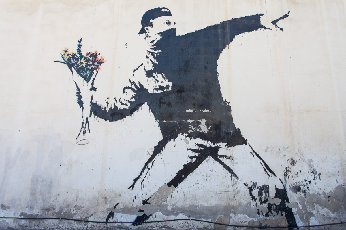 Banksy Flower Thrower Radical Art of Berlin