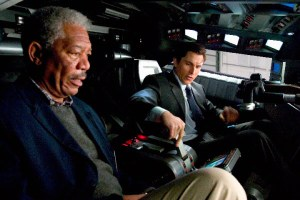 Batman Begins Morgan Freeman as Lucius Fox and Christian Bale as Bruce Wayne