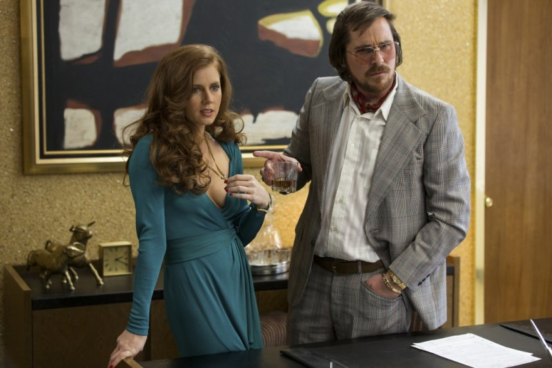 Francois Duhamel/Annapurna Productions Sydney Prosser (Amy Adams) and Irving Rosenfeld (Christian Bale) attempt to scam an under cover agent.