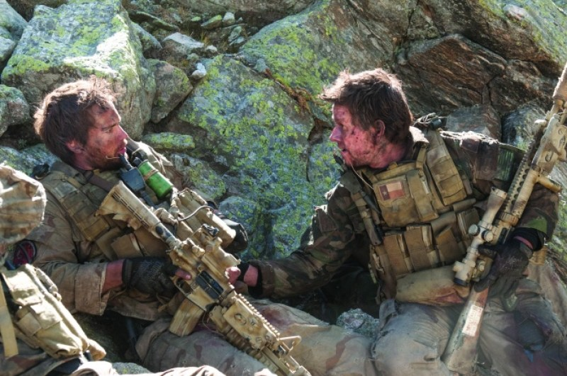 """Gregory E. Peters/Universal Studios Michael Murphy (Taylor Kitsch) and Marcus Luttrell (Mark Wahlberg) in """"Lone Survivor."""""""