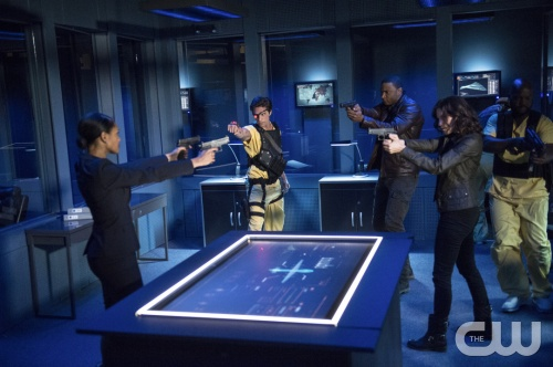 "Cate Cameron/The CW Cynthia Addai-Robinson as Amanda Waller, Michael Rowe as Floyd Lawton (""Deadshot""), David Ramsey as John Diggle, and Audrey Marie Anderson as Lyla."