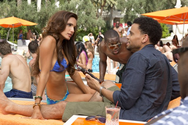 Matt Kennedy/Screen Gems A sexy Brazillian woman stops to talk to Dominic (Michael Ealy) while Cedric (Kevin Hart) watches on at the pool at Caesar's Palace.