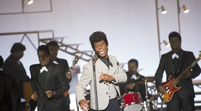 D. Stevens/Universal Pictures James Brown (Chadwick Boseman) performs.