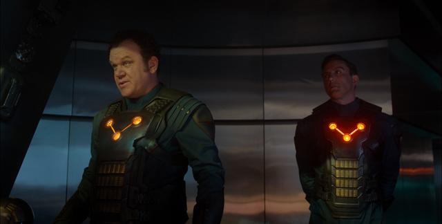 Marvel Rhomann Dey (John C. Reilly) and Nova Corp Officer (Peter Serafinowicz)