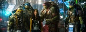 "Industrial Light & Magic / Paramount  Michelangelo, Leonardo, Megan Fox as April O'Neil, Raphael, and Donatello in ""Teenage Mutant Ninja Turtles."""
