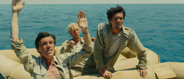 "Universal Pictures Mac (Finn Witrock), Phil (Domhnall Gleeson) and Louie (Jack O'Connell) are adrift in ""Unbroken"","