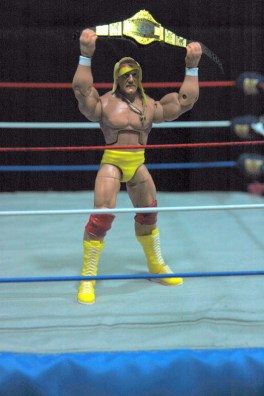 Hulk Hogan Defining Moments figure - holding title up