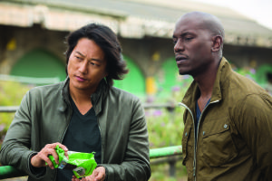 Giles Keyte/Universal Pictures Han (Sung Kang) and Roman (Tyrese Gibson) on stake out.