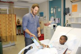 Chris Pratt at Our Lady of the Lake Children's Hospital - presenting Legos to a patient