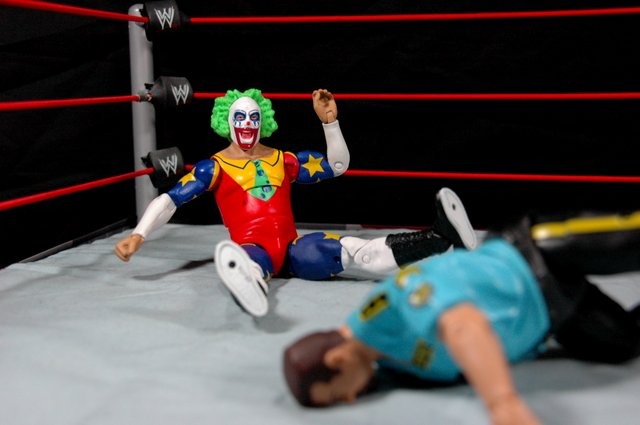 Doink the Clown WWE Mattel figure review - laughing at Bossman