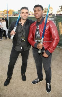 SAN DIEGO, CA - JULY 10: Actors Oscar Isaac (L) and John Boyega and more than 6000 fans enjoyed a surprise `Star Wars` Fan Concert performed by the San Diego Symphony, featuring the classic `Star Wars` music of composer John Williams, at the Embarcadero Marina Park South on July 10, 2015 in San Diego, California. (Photo by Jesse Grant/Getty Images for Disney) *** Local Caption *** Oscar Isaac; John Boyega