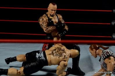 Wrestlemania 30 Undertaker Mattel -locking in kimura on Lesnar