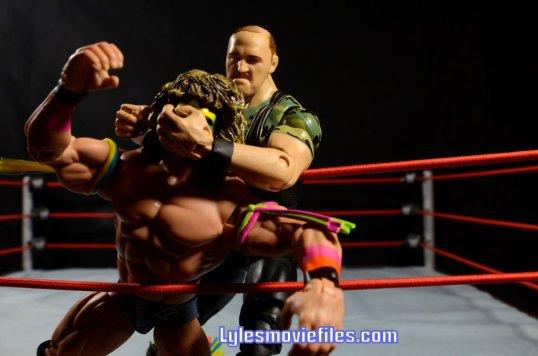 Sgt. Slaughter WWE Hall of Fame figure - grabbing Ultimate Warrior