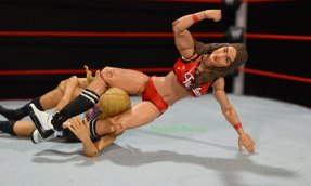 Nikki Bella Mattel WWE figure - leg scissors on Emma