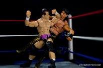 Dean Malenko WWE Elite 37 - elbow smash into corner