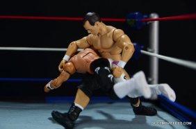 Dean Malenko WWE Elite 37 - gut buster on Rey Mysterio Jr.