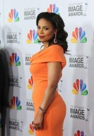 Sanaa Lathan -orange dress
