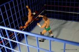 Wicked Cool Toys authentic classic cage -Orton throws Superfly into cage