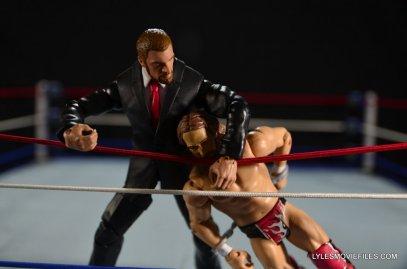Mattel WWE Battle Pack - Triple H vs Daniel Bryan -dragging Bryan across the ropes