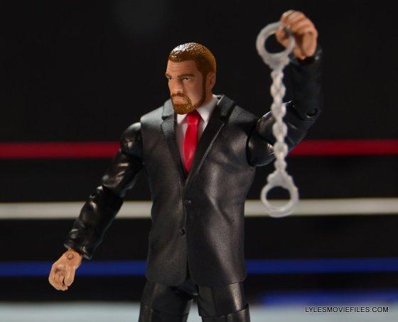 Mattel WWE Battle Pack - Triple H vs Daniel Bryan -holding handcuffs up
