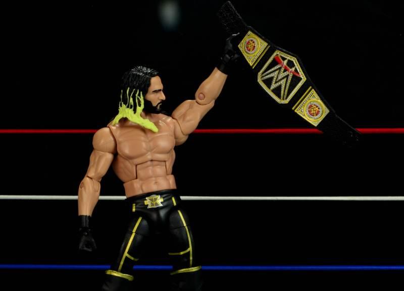Seth Rollins Mattel exclusive -holding title belt after win