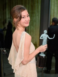 """LOS ANGELES, CA - JANUARY 30: Actress Kimiko Glenn, winner of the award for Outstanding Performance by an Ensemble in a Comedy Series for """"Orange Is the New Black,"""" poses backstage at the The 22nd Annual Screen Actors Guild Awards at The Shrine Auditorium on January 30, 2016 in Los Angeles, California. 25650_014 (Photo by Larry Busacca/Getty Images for Turner) *** Local Caption *** Kimiko Glenn"""