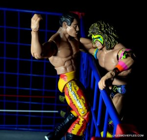 Ultimate Warrior Hall of Fame figure -battling Rude atop the cage