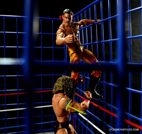 Ultimate Warrior Hall of Fame figure -stopping Rude from climbing
