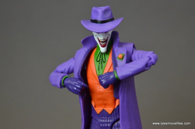 dc-icons-the-joker-figure-review-pulling-jacket-open
