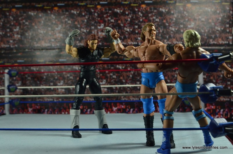 wwe-basic-sid-justice-battering-flair-undertaker-attacking