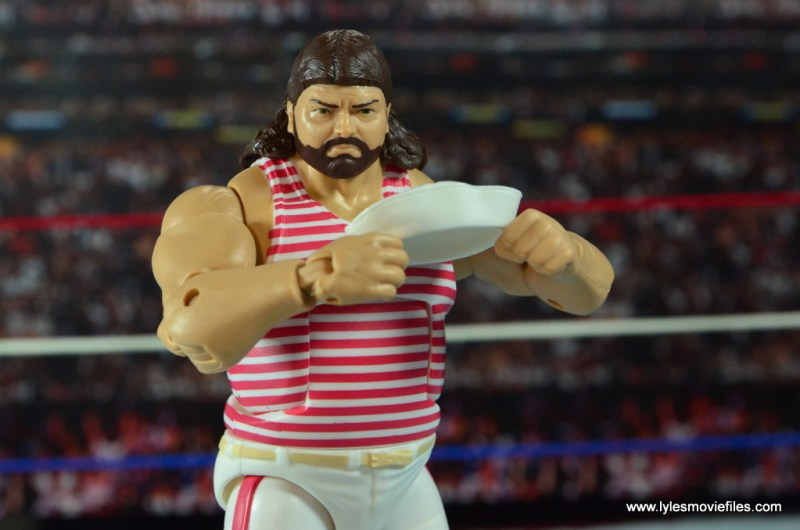 wwe-elite-44-tugboat-figure-review-holding-hat