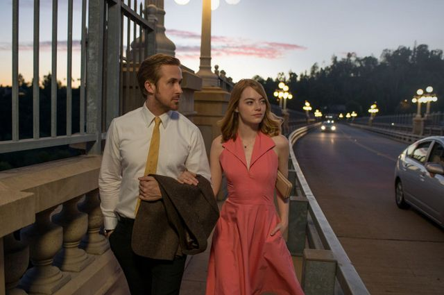 La La Land review - Ryan Gosling and Emma Stone walking