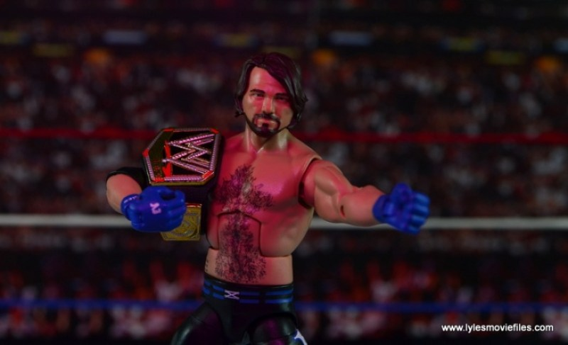 WWE Elite AJ Styles figure review - aiming with WWE title