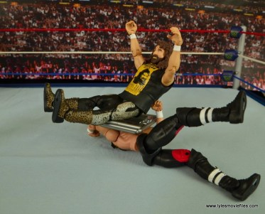 WWE Elite 48 Cactus Jack figure review -senton to Triple H
