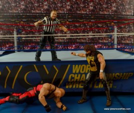 WWE Elite 48 Cactus Jack figure review -stalking Vader outside
