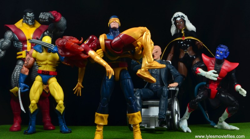 Marvel Legends Cyclops and Dark Phoenix figure review - Cyclops holding Dark Phoenix with X-Men marvel legends reviews