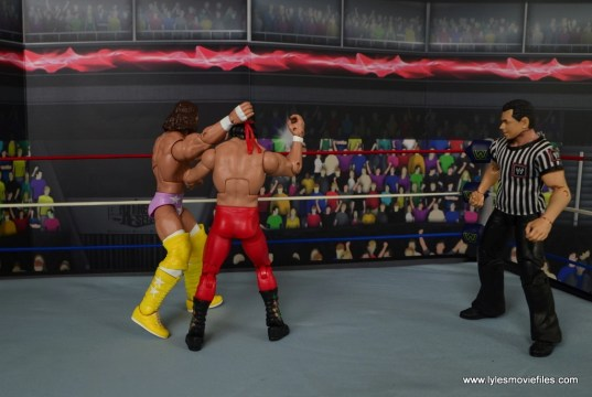 WWE Defining Moments Macho Man Randy Savage figure review - throwing Ricky Steamboat over top rope