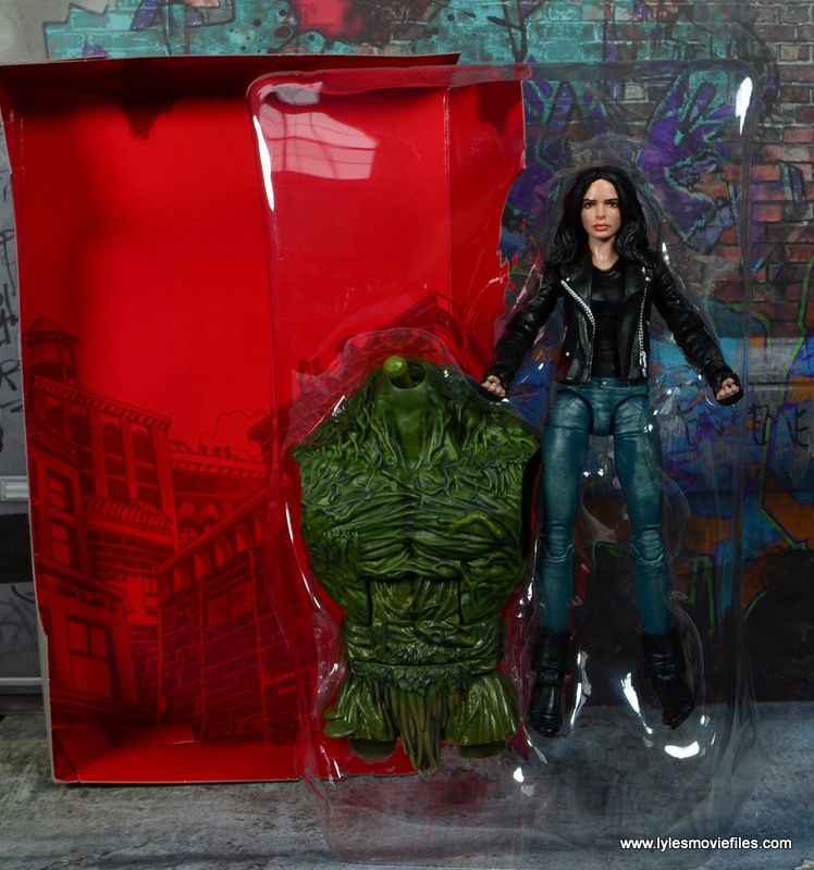 Marvel Legends Jessica Jones figure review - backdrop and figure in tray