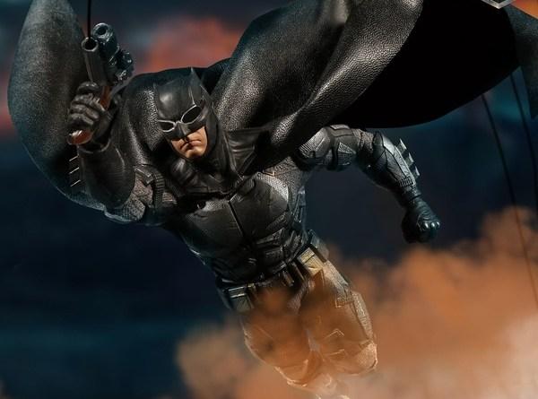Mezco One12 Collective Justice League Movie Tactical Suit Batman figure gliding across