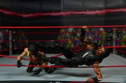 WWE Elite 45 Roman Reigns figure review - apron kick to Seth Rollins